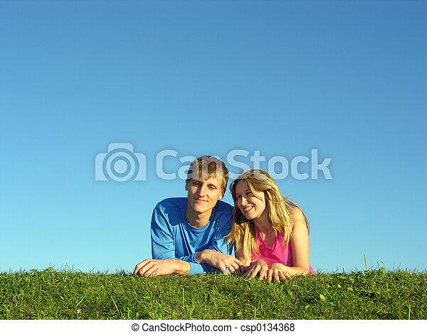 couples lie on grass - csp0134368