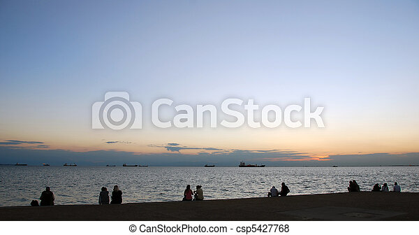 Couples watching the sunset - csp5427768