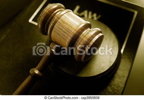 court gavel and law book, closeup from above - csp3950839