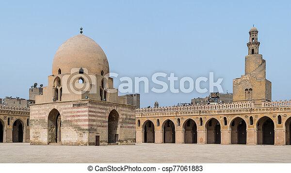 Courtyard of Ibn Tulun public historical mosque with ablution fountain and the minaret, Cairo, Egypt - csp77061883