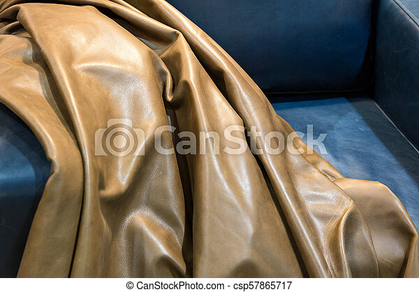 Cow hide leather tan background in the store. - csp57865717