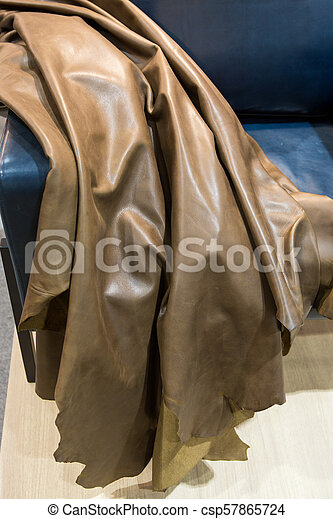 Cow hide leather tan background in the store. - csp57865724