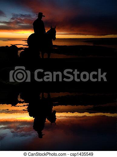 Cowboy at Watering Hole - csp1435549