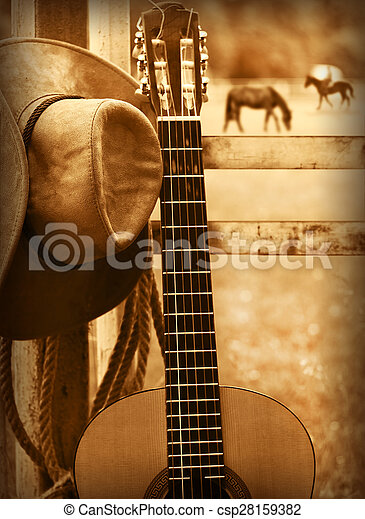Cowboy hat and guitar.American music background - csp28159382