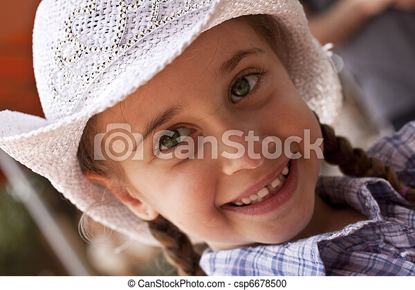 Cowgirl princess. Little girl with blond braids wearing a white ... cfe63b81f38e