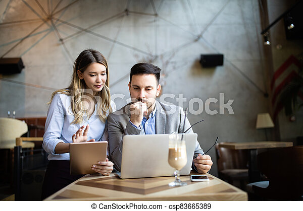 Coworker business colleagues working together in office - csp83665389