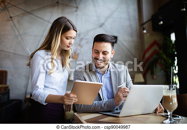 Coworker business colleagues working together in office - csp90049987