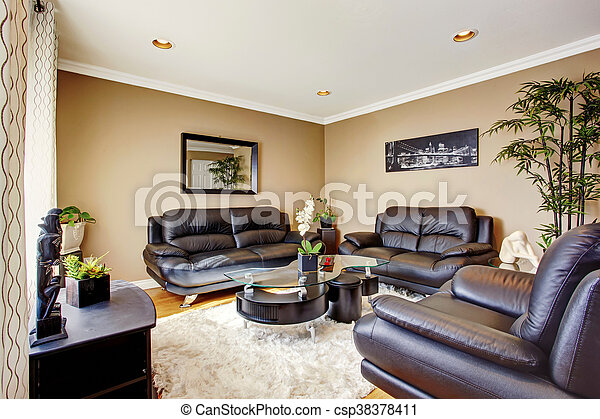 Cozy and luxury living room with black leather sofa set and modern coffee  table