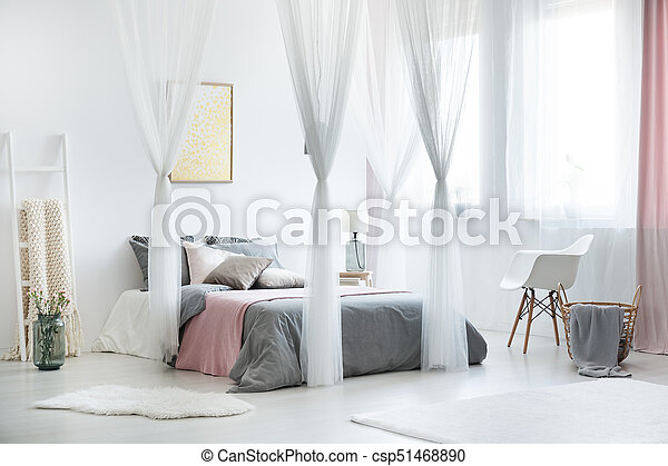 Cozy Bright Bedroom Interior White Chair Next To Bed With Canopy In Cozy Bright Bedroom Interior With White Fur On Floor