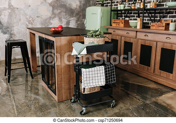 Cozy loft kitchen with dinning table, chairs and metal storage racks on wheels - trolley - csp71250694