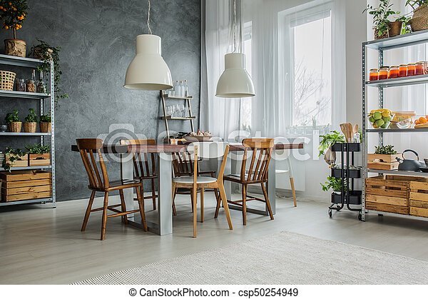 Cozy loft with dinning table - csp50254949