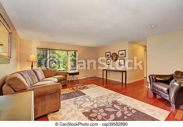 Cozy Spacious Living Room With Cherry Wood Floor Entrance Door View