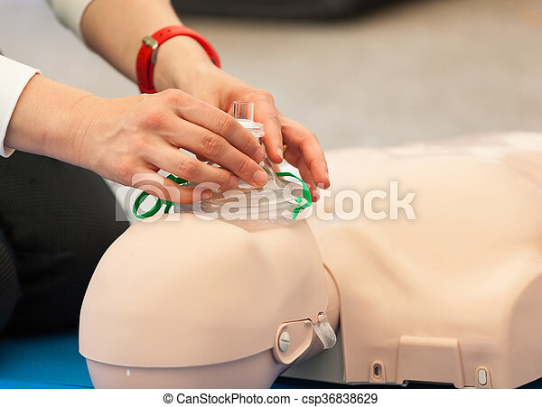 CPR training with dummy - csp36838629