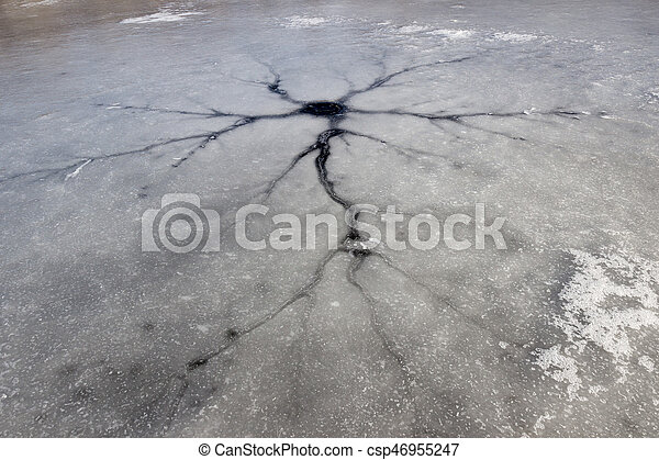 Crack in the ice on frozen lake surface - csp46955247