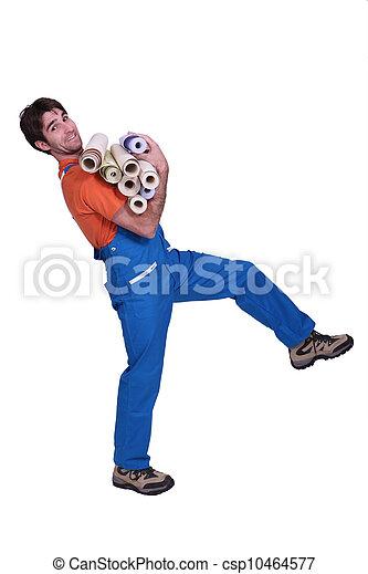 craftsman carrying rolls of wallpaper - csp10464577