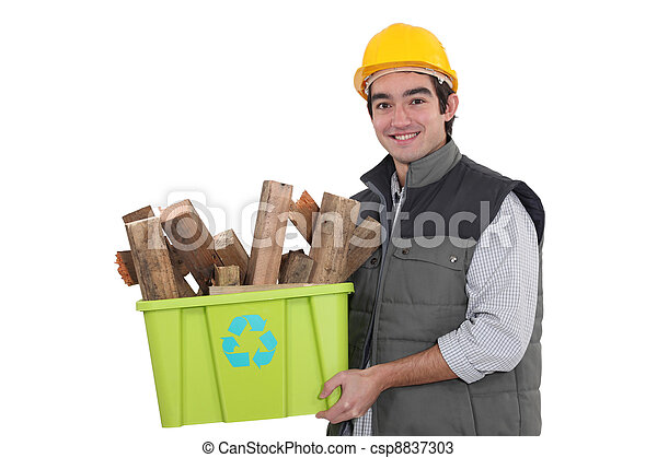 craftsman holding a box with recycling materials - csp8837303