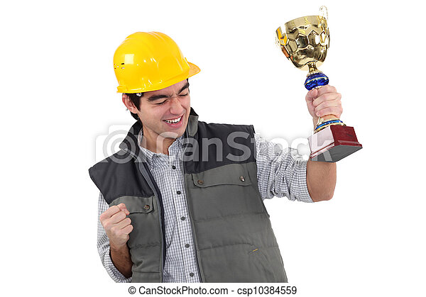 craftsman holding a golden cup - csp10384559