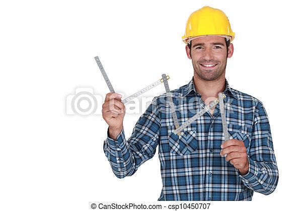 craftsman holding a meter - csp10450707