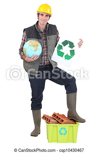 craftsman holding a recycling label and a globe - csp10430467