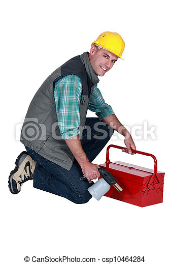 craftsman holding his tool box and welding torch - csp10464284