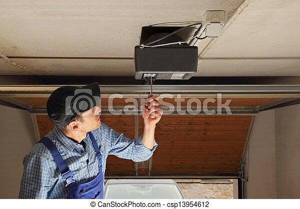 Craftsman installing a electrical garage door opener - csp13954612