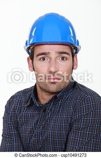 craftsman looking surprised - csp10491273