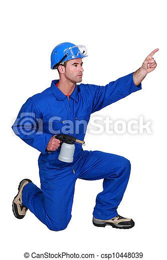 craftsman pointing at something - csp10448039