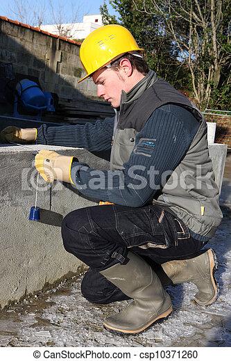 craftsman taking measurements - csp10371260