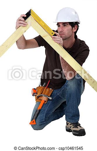 craftsman taking measurements - csp10461545