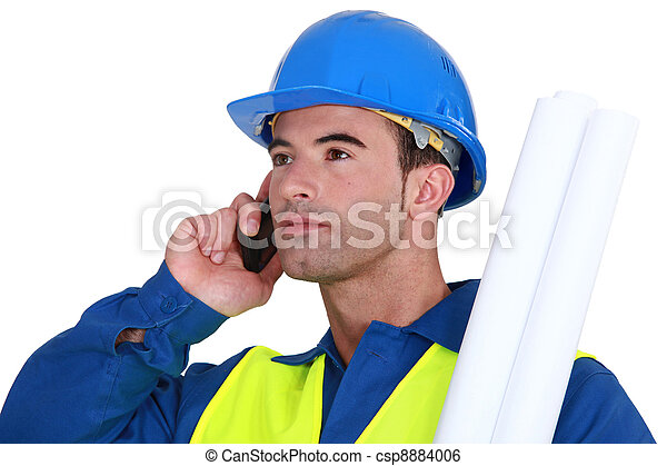 craftsman talking o his cell phone - csp8884006