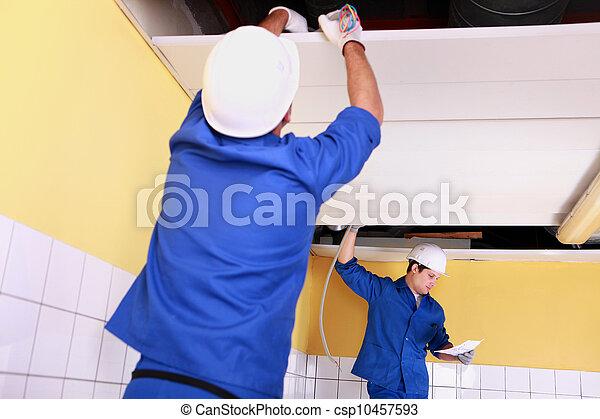 craftsmen wiring a building - csp10457593