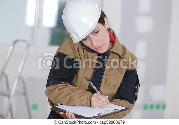 craftswoman taking notes - csp52068679