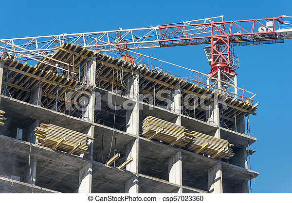 Crane and high-rise residential building. Real Estate Construction - csp67023360