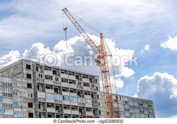 crane near building on Cloudy sky background - csp53280932