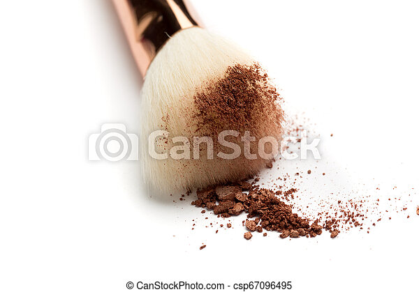 crashed face powder, blushers, eyeshadow and brush on white background. Neutral colored makeup products - csp67096495