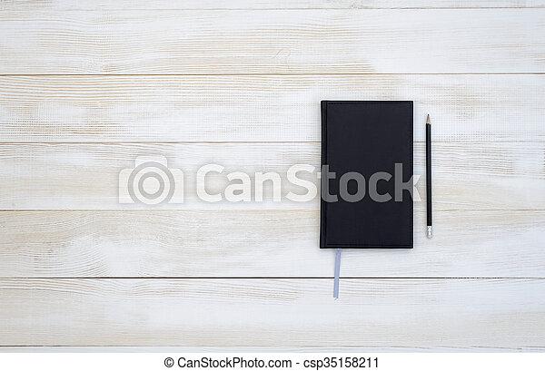 Crayon bureau arrière plan. cuir sommet bureau bois cahier
