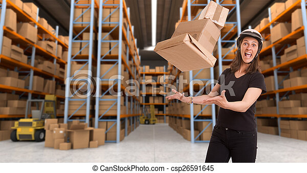 Crazy female courier at warehouse a - csp26591645
