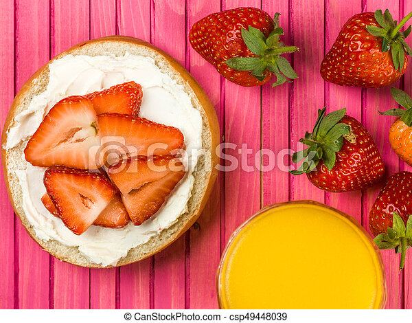 cream cheese and strawberry bagel against a pink background stock rh canstockphoto co uk Bagel Cartoon Clip Art Bagel Cartoon