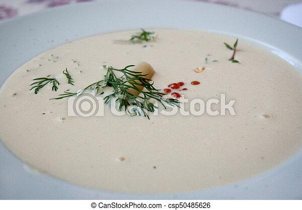 Cream soup puree with asparagus , shrimp and red caviar . - csp50485626
