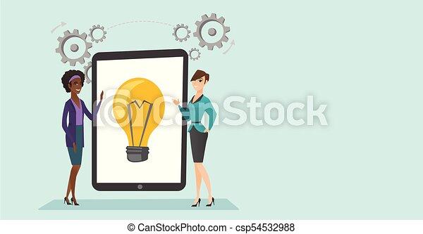 Creative business women discussing business ideas. - csp54532988