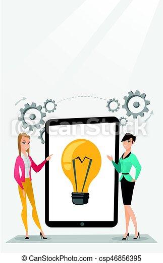 Creative businesswomen discussing business ideas. - csp46856395