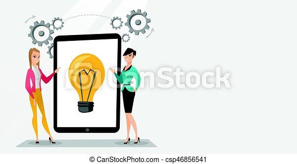 Creative businesswomen discussing business ideas. - csp46856541