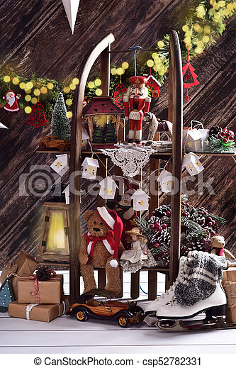 Creative Christmas Decoration And Toys On Shelves Made Of Wooden Sled