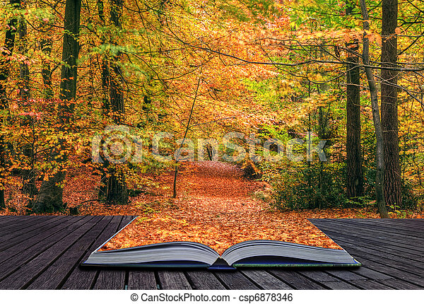 Creative concept idea of Beautiful autumn fall forest scene with vibrant colors and excellent detail coming out of pages in magical book - csp6878346