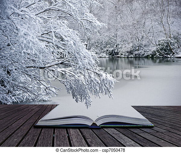 Creative concept idea of Winter landscape coming out of pages in magical book - csp7050478