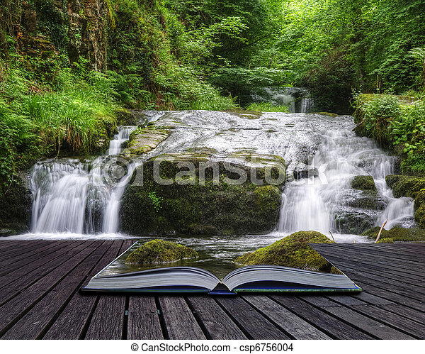 Creative concept image of flowing forest waterfall coming out of pages in magical book - csp6756004