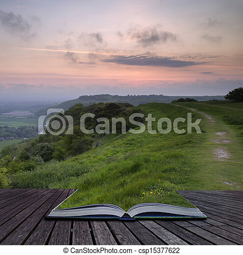 Creative concept pages of book Beautiful vibrant sunrise over rolling countryside landscape - csp15377622