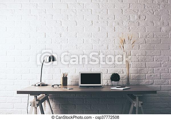 Creative desktop on brick background - csp37772508