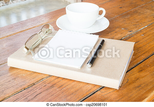 Creative time with cup of coffee and book - csp20698101