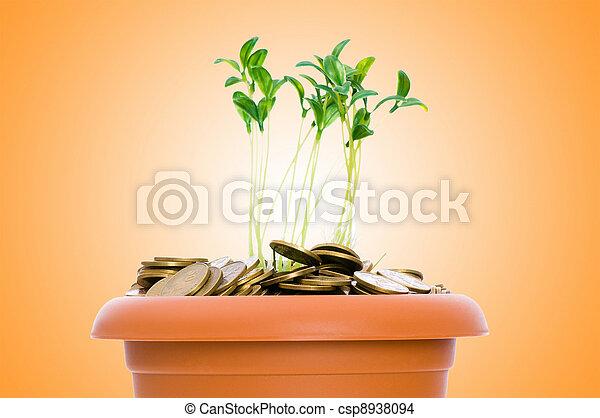 Semillas verdes creciendo de la pila de monedas - csp8938094